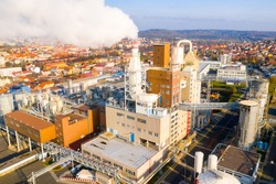 Aerial view to industrial area with chemical plant. Smoking chimney from factory. Air pollution and climate change theme. Heavy industry in Czech Republic as a co2 emissions source. European Union.