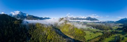 aerial view to klause valley to ruin ehrenberg, castle hohes schloss and reutte village on sunrise with morning fog