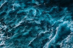 Aerial view to ocean waves. Blue water background. Dramatic colors photo.