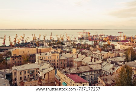 aerial view to Odessa, roofs, port and sea at sunset or sunrise  #737177257