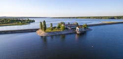 Aerial view to old abandoned pumping station on dam at Severskiy Donets river, Pechenegi reservoir,  Ukraine
