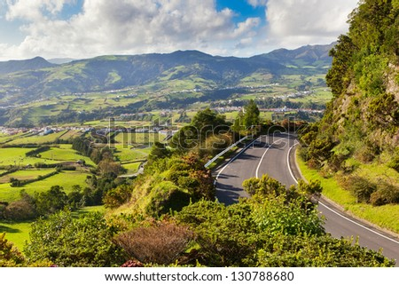 Aerial view to settlement and fields near mountains, San Miguel, Azores, Portugal