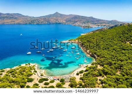 Aerial view to the beautiful beach of Moni island, next to the village Perdika on Aegina island with turquoise sea, Saronic Gulf, Greece