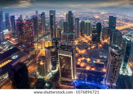 Aerial view to the iluminated city center of Doha, Qatar during evening time