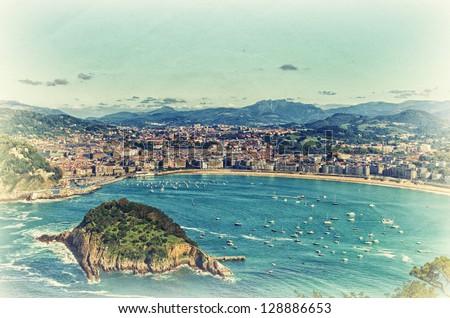 Aerial view to the San Sebastian. Retro style artistic photo.