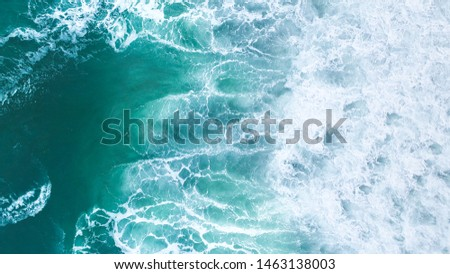 Aerial view to tropical beach and wave blue ocean at New Zealand. Aerial drone shot of turquoise sea water at the beach - space for text.