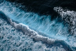 Aerial view to waves in ocean Splashing Waves. Blue clean wavy sea water.