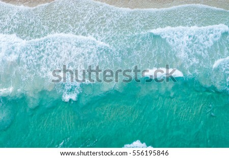Aerial view. Top view.amazing nature background.The color of the water and beautifully bright.Azure beach with rocky mountains and clear water of Thailand ocean at sunny day.
