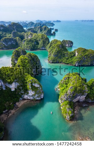 Aerial view Vung Vieng floating fishing village and rock island, Halong Bay, Vietnam, Southeast Asia. UNESCO World Heritage Site. Junk boat cruise to Ha Long Bay. Famous destination of Vietnam