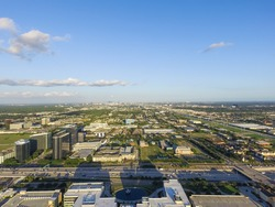 Aerial view Westchase district, a business management district, with some residential and retail elements, Bounded by Westheimer, Gessner and Sam Houston Tollway. Houston Downtown is in background.