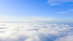 Aerial view White clouds in blue sky. Top. View from drone. Aerial bird's eye. Aerial top view cloudscape. Texture of clouds. View from above. Sunrise or sunset over clouds