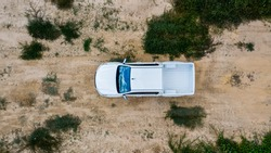 Aerial view white off-road car vehicle, Car 4x4 wheel drives off-road on safari, White truck car park on sand.