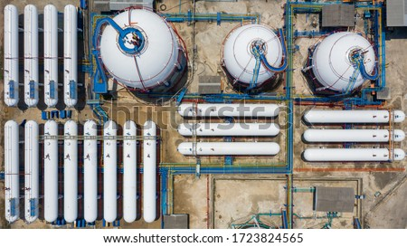 Aerial view white storage tank gas in station LPG gas, LNG or LPG distribution station facility, Oil and gas fuel manufacturing industry.