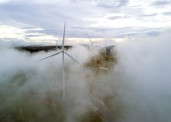 Aerial view Wind turbines and fog for generating electricity in Southeast Asia.