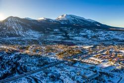 Aerial view winter wonderland sunset in Frisco Colorado