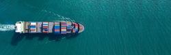 Aerial view with filled container ship - import export logistics or transport concept, banner