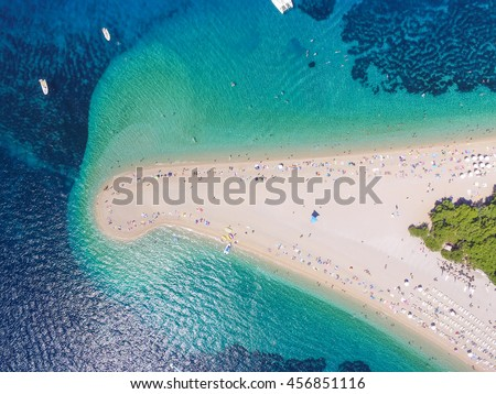 Aerial view Zlatni rat beach in Bol, Island Brac, Croatia #456851116