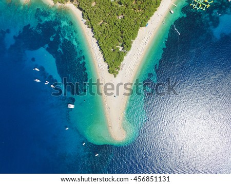 Aerial view Zlatni rat beach in Bol, Island Brac, Croatia #456851131