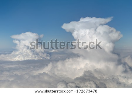 aerial viewof  two cumulonimbus clouds on blue sky background