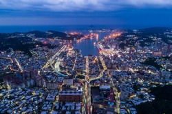 Aerial views of Keelung City light and Keelung Harbor at night.