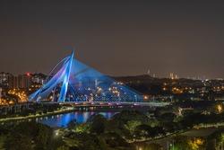 Aerial views of Putrajaya bridge lighted up in blue