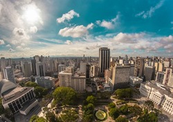 Aerial wide-angle landscape view of urbanized center with colorful skyscrapers in the morning - Santos Andrade Square - Curitiba, capital of Paraná State, Brazil