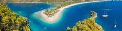 aerial wide angle panorama of famous resort Oludeniz in Turkey with sand beach and yachts