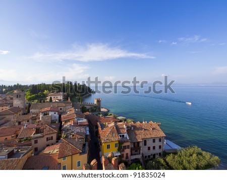Aerial wide angle view of the Scaliger castle of Sirmione, Lake Lago Di Garda, Italy / Sirmione town /