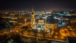 Aerial winter night view to Holy Annunciation Cathedral - Blagovischenskiy sobor, with panorama of city in Kharkiv, Ukraine