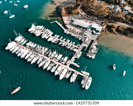 aeriel shot of a marina with plenty of boats and clear blue water  #1429735709