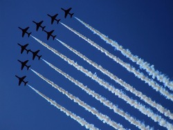 Aerobatic group formation at blue sky during Air Show 2009 in Radom, Poland