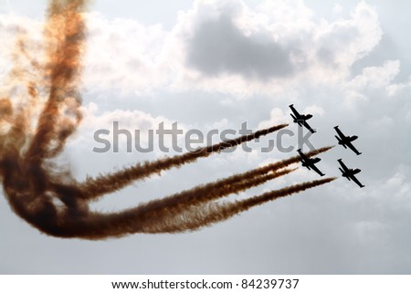 Aerobatic team on the sky on the airshow, Slovakia, Central Europe - stock photo