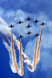 Aerobatics team flying in formation.