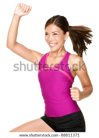 Aerobics fitness woman doing dance training move smiling fresh and happy with energy. Beautiful multiracial female fitness model.
