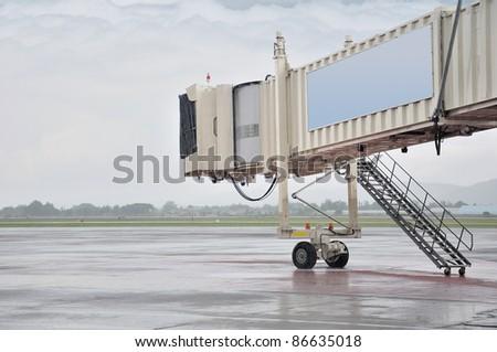 aerobridge in plane parked with rainy - stock photo