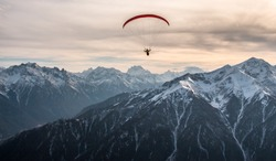 Aerofoto of the mountain Landscape and paraglader, The Caucasus.