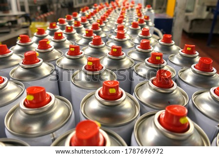 Aerosol cans in busy factory  Foto stock ©