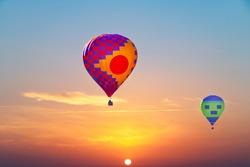 Aerostatic Balloons flying at sunrise