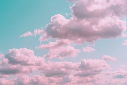 Aesthetic background with beautiful turquoise sky with pink clouds and circle light frame. Minimal creative concept of angel paradise