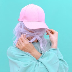 Aesthetic girl in stylish accessories b-boy cap. Fresh pastel colours monochrome fashion design trends