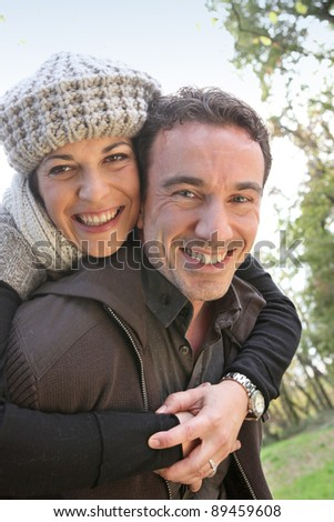 Affectionate couple taking a walk through park