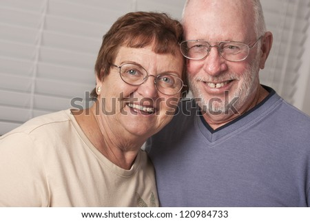 Affectionate Happy Senior Couple Portrait Indoors.