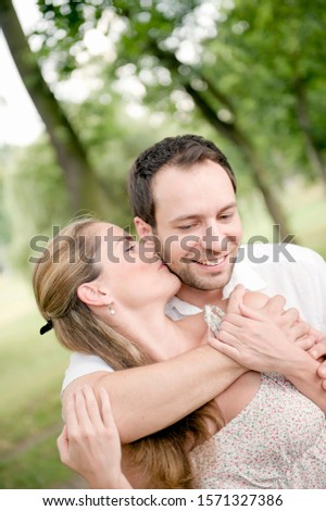 Affectionate mid adult couple in park
