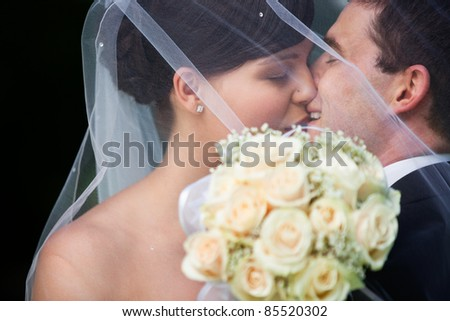 Affectionate newly wed couple kissing