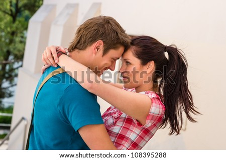 Affectionate young couple hugging looking at each other