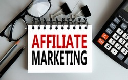 Affiliate Marketing.text on white paper on gray background