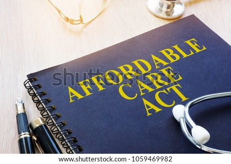 Affordable Care Act ACA and stethoscope on a table. Imagine de stoc ©