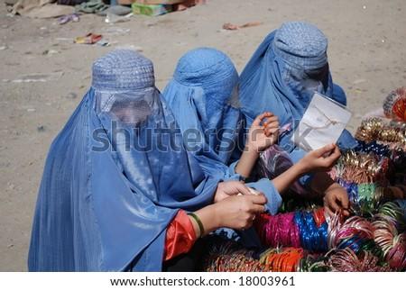 Afghan women in burka buy jewelry