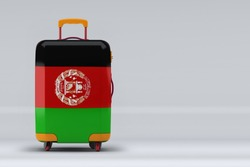 Afghanistan national flag on a stylish suitcases on color background. Space for text. International travel and tourism concept. 3D rendering.