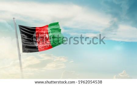 Afghanistan national flag waving in beautiful sky.